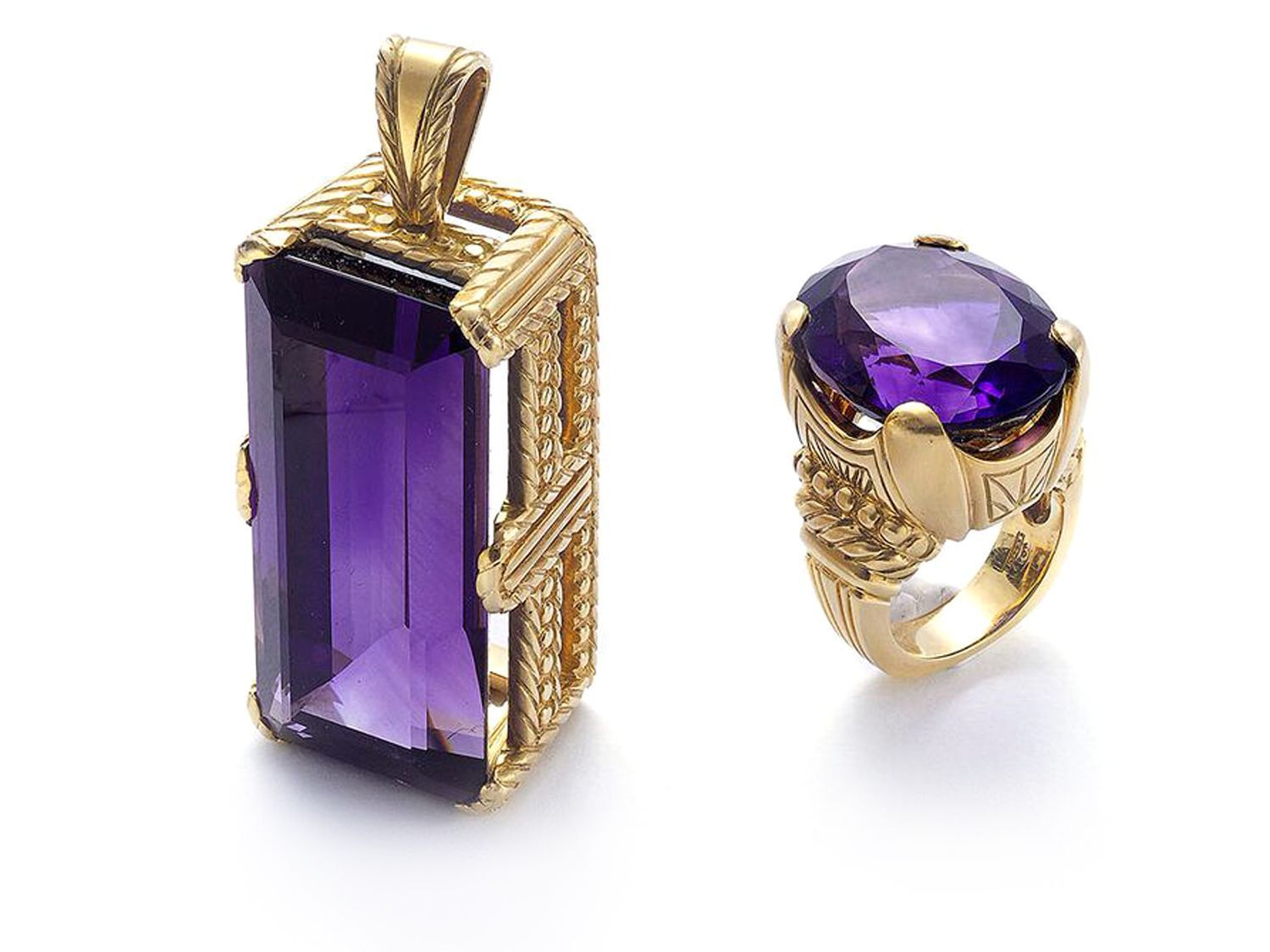 An amethyst pendant and ring suite the pendant is set with a long