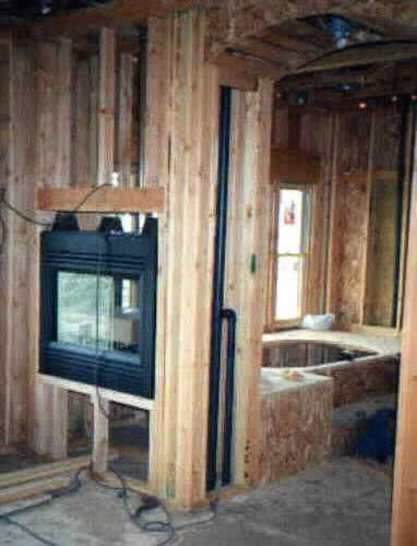 See through fireplace in master bedroom suite
