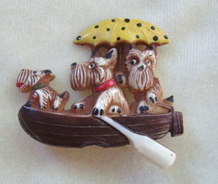 Vintage celluloid Scotties in a boat Czech pin