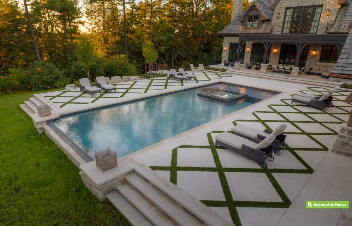 Rectangle pools with grass decks the large pool deck in for Poolside ideas