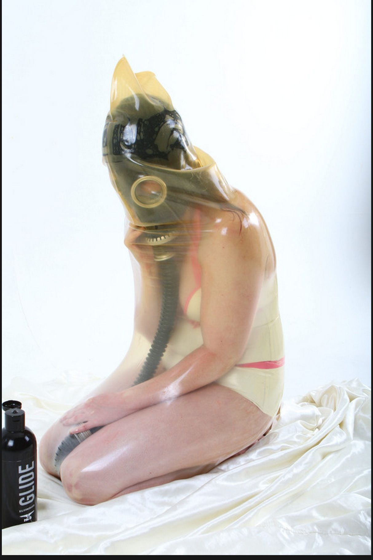 image Girl in mask seals herself in vaccuum bag
