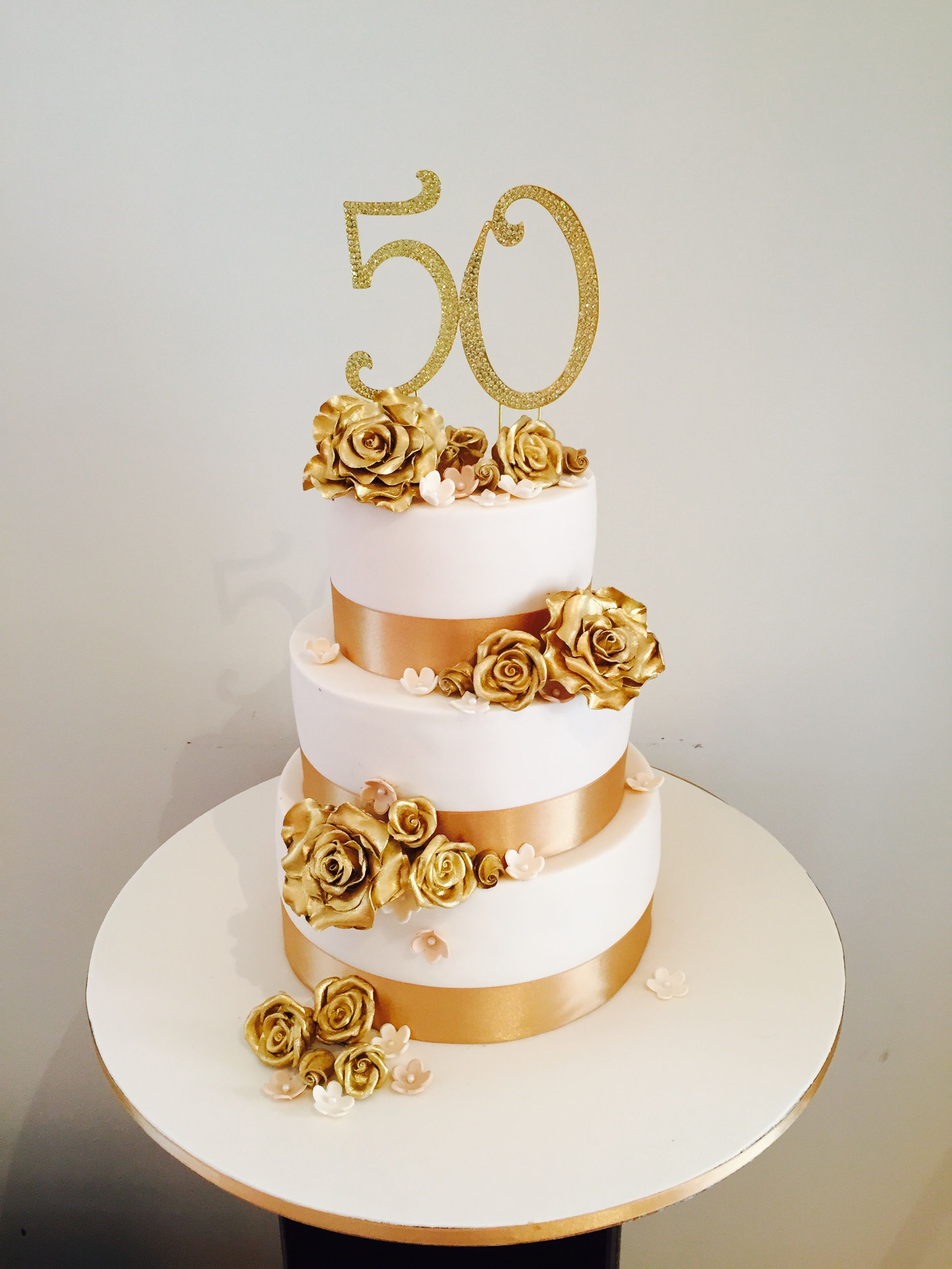50th anniversary white and gold cake decorated with