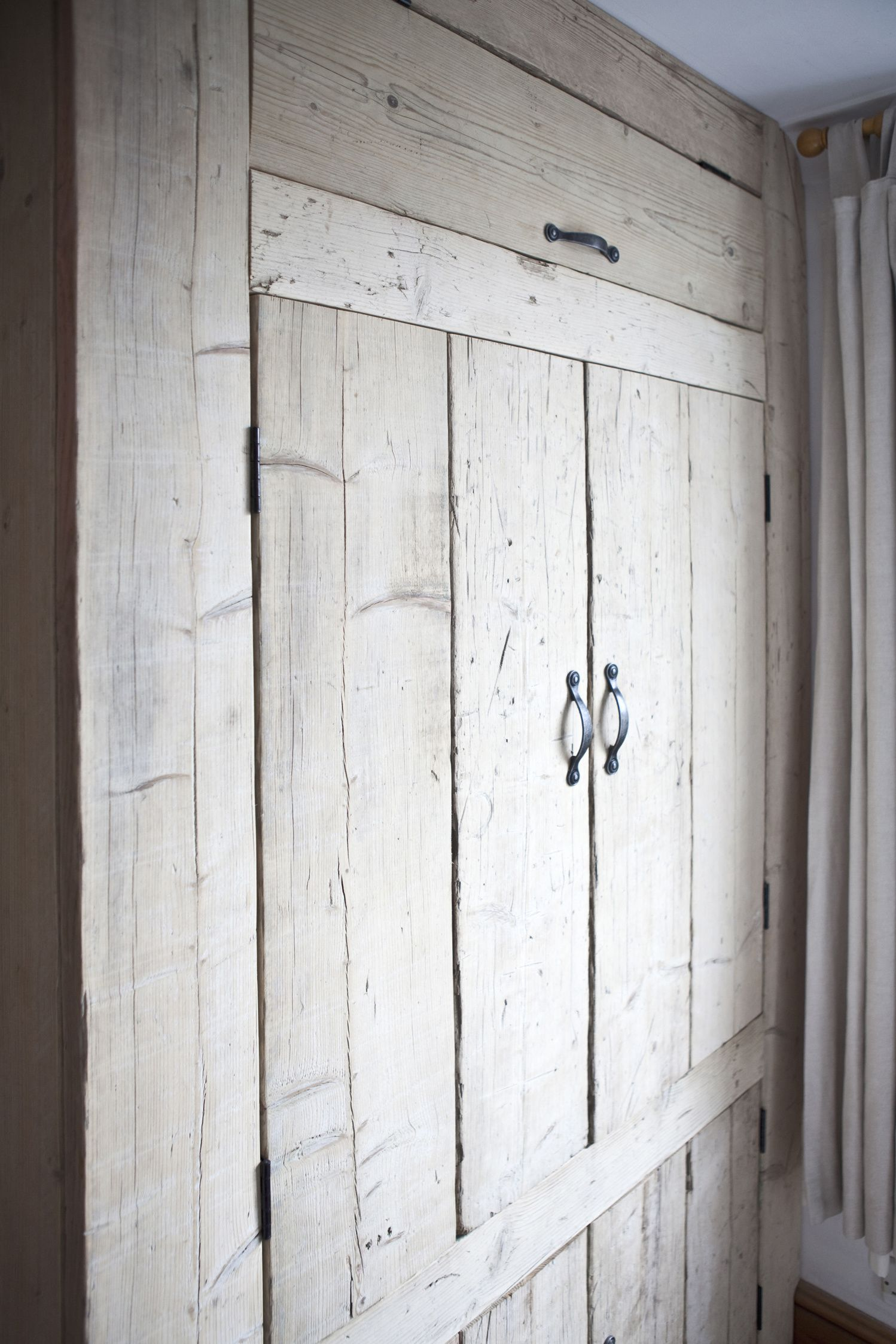 rustic built in bedroom wardrobe made from reclaimed and repurposed