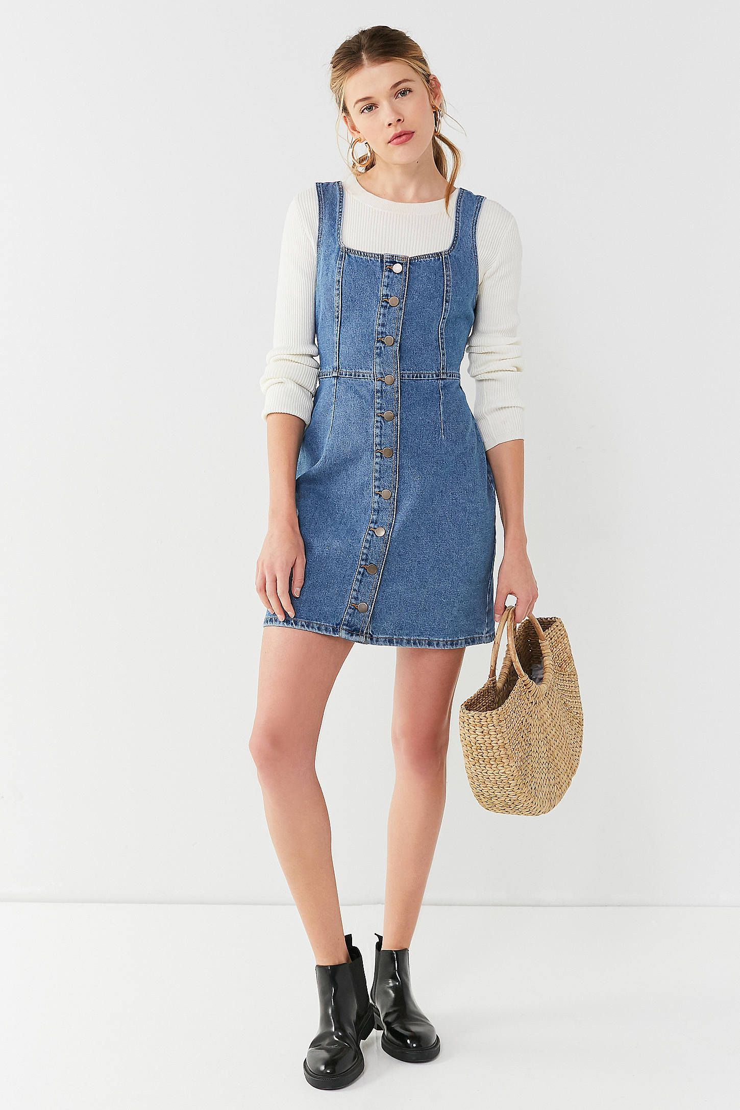 a0472bcc10 Shop UO Button-Down Denim Mini Dress at Urban Outfitters today. We carry  all the latest styles, colors and brands for you to choose from right here.