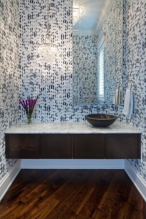 Contemporary powder room features walls clad in Harlequin ...