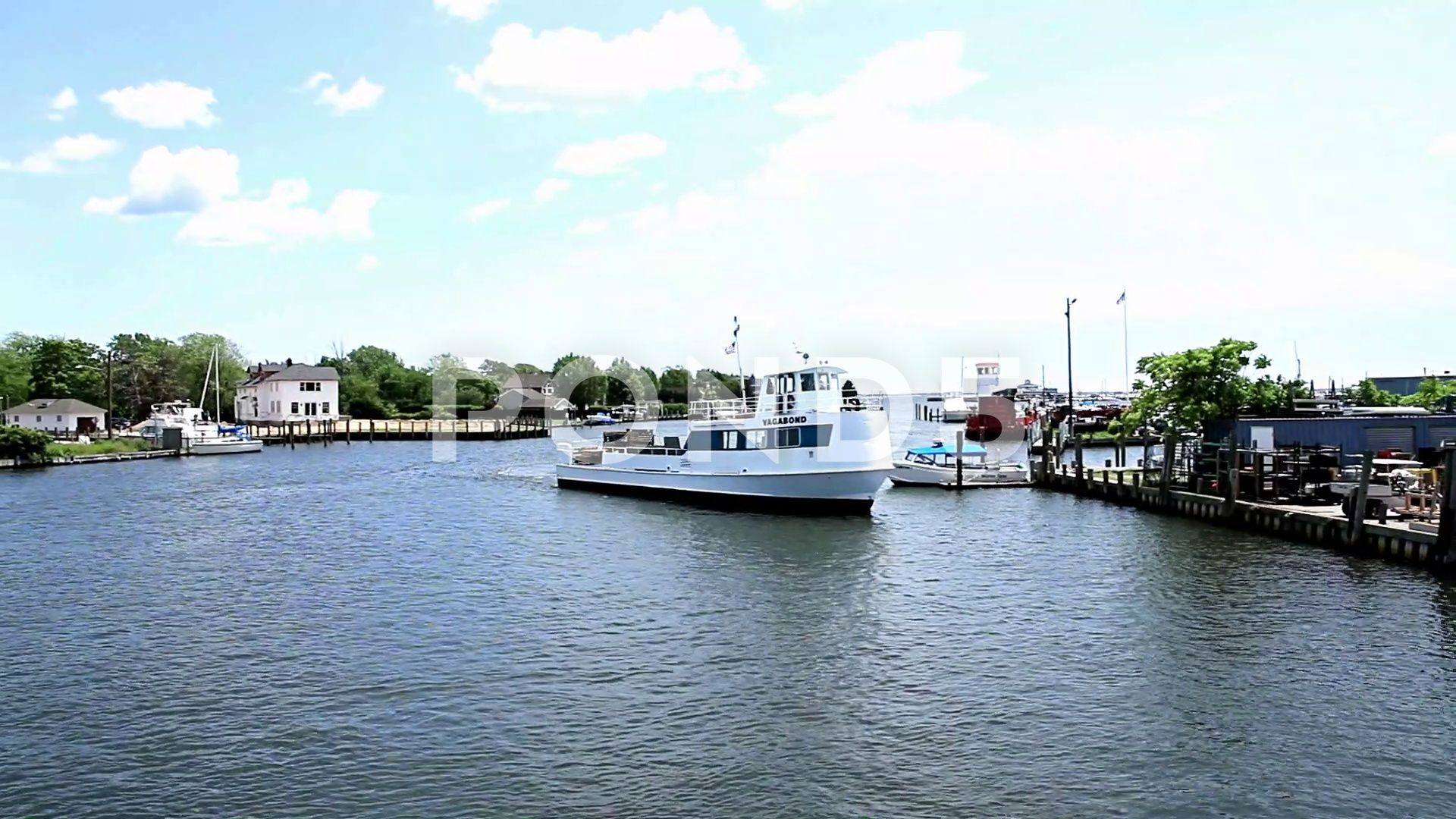 Fire island ferry boat backing out of the dock in bay