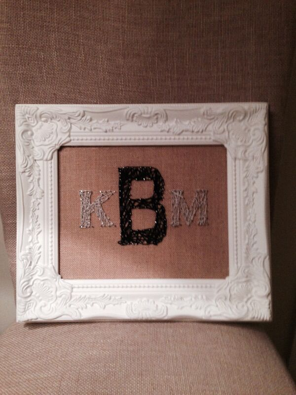 Monogram string art on burlap framed. Made to hang in a baby's room.