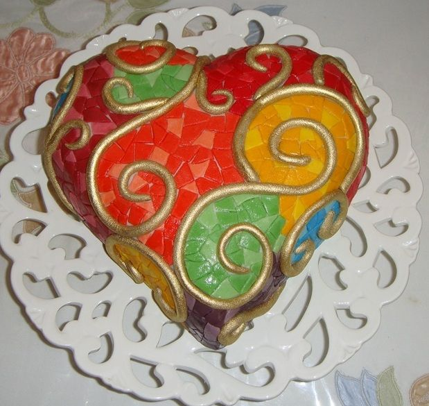 Rainbow Heart - I baked this cake for my husband's birthday and the cake is red velvet cake.I used wilton's color, after rolled each colors I cut out like a strip then I cut them disorderly and stuck with water on the fondant.
