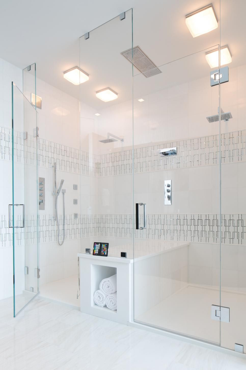 This luxurious walk-in shower can fit two at a time—with a center ...
