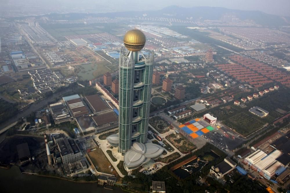 A new skyscraper has been unveiled in Huaxi village in China's Jiangsu province to commemorate the 50th anniversary of the founding of the country's richest village.  Back in the 1950s, Huaxi was a small village with only 576 residents. But in 2003, it became the first village to generate an astonishing 10 billion yuan ($1.5 billion) of Gross Domestic Product,China's Richest Village Gets a Skyscraper #building #cars #skyscraper