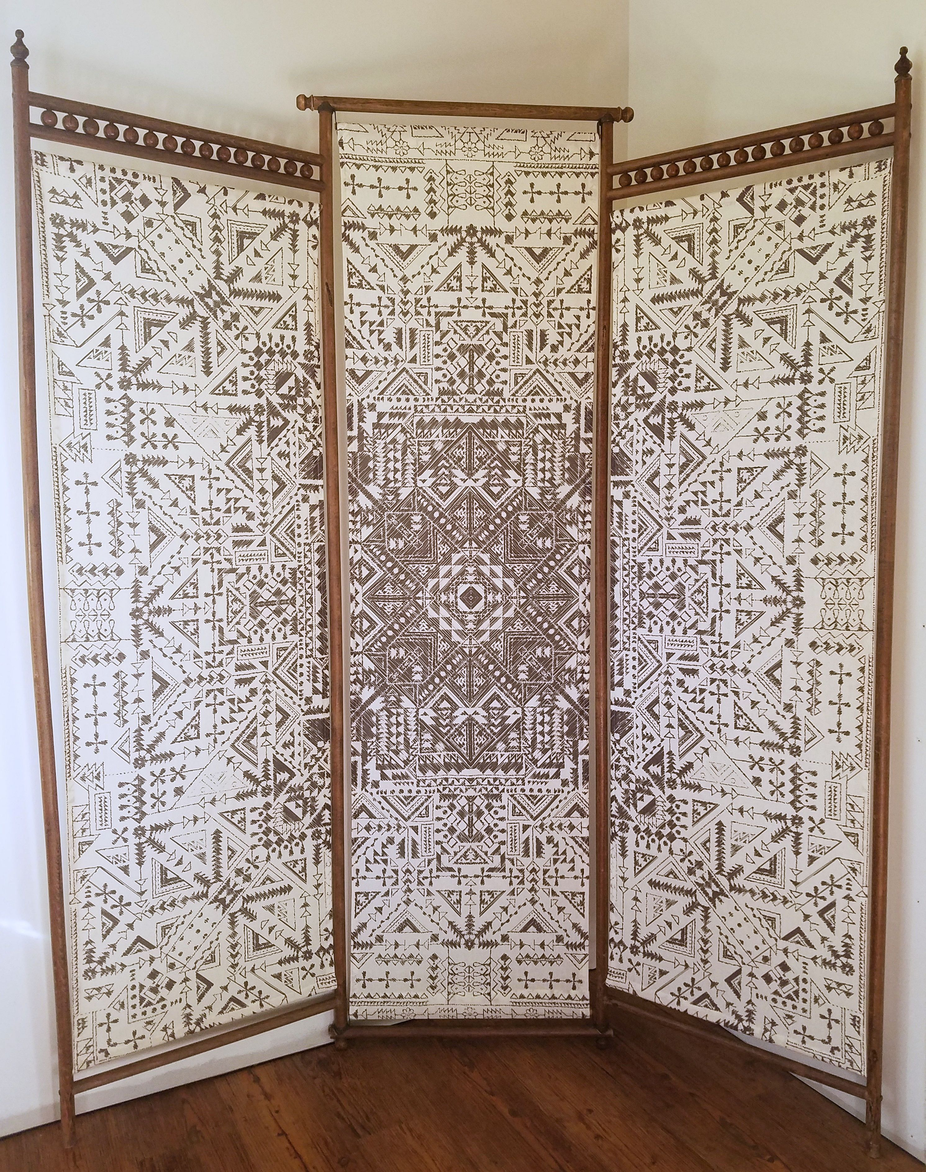 Updated an old wooden room divider using a tapestry really happy