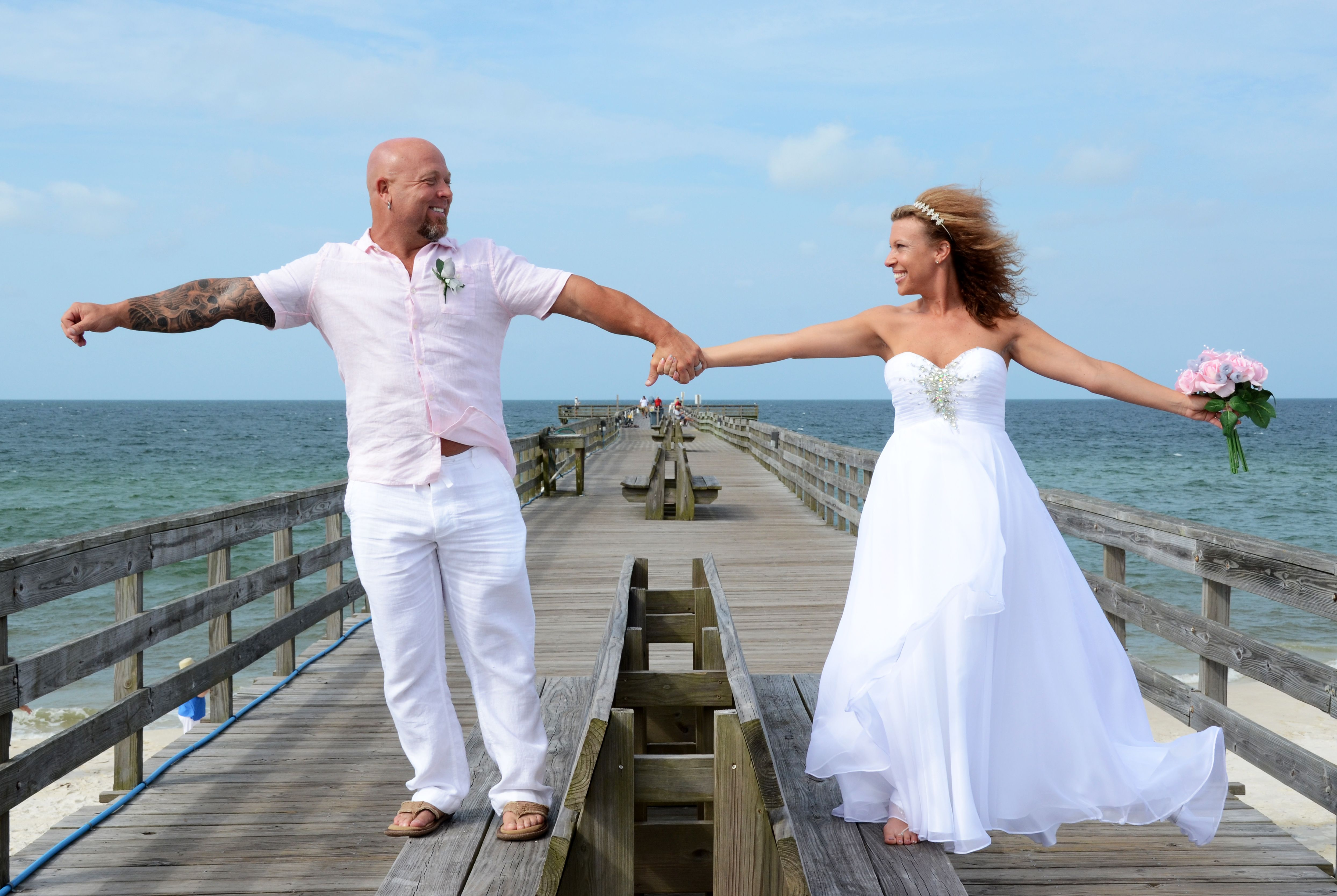 Newlyweds Celebrate On The Fishing Pier After Their Mexico Beach Florida Destination Wedding