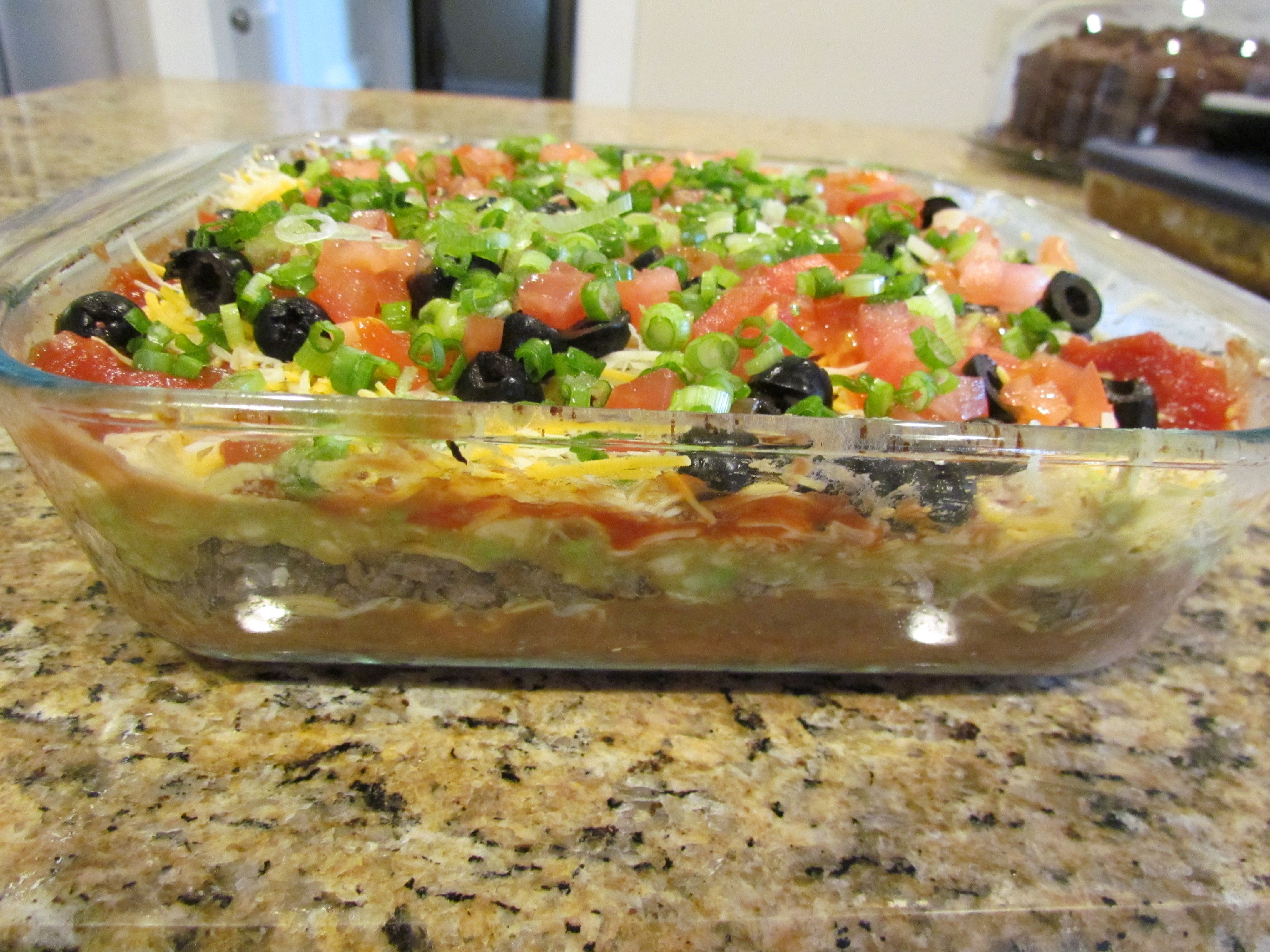 7 Layer Nacho Dip With Cumin Infused Ground Beef Refried Beans Guacamole Sour Cream Salsa Monterey Jack Ched Layered Nacho Dip Superbowl Party Food Food