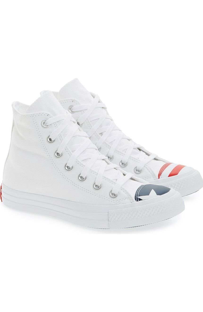 dfc313a0d79 How cool are these white high-top sneakers with the American flag detailing  the cap toe