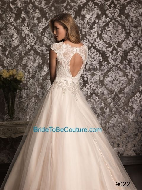 ALLURE BRIDAL - Romantic and classic. This ball gown combines lace and English Net perfectly. The lace bodice features a scoop neckline with cap sleeves while Swarovski crystals accent the waistline.