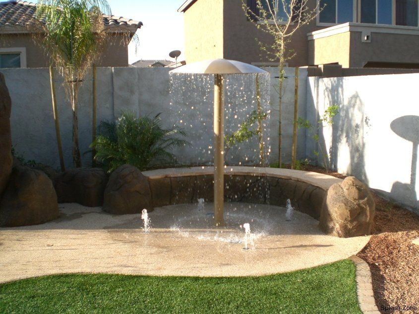 Cheaper Than A Pool Safer Too Backyard Splash Pad Backyard Water Parks Backyard Water Feature