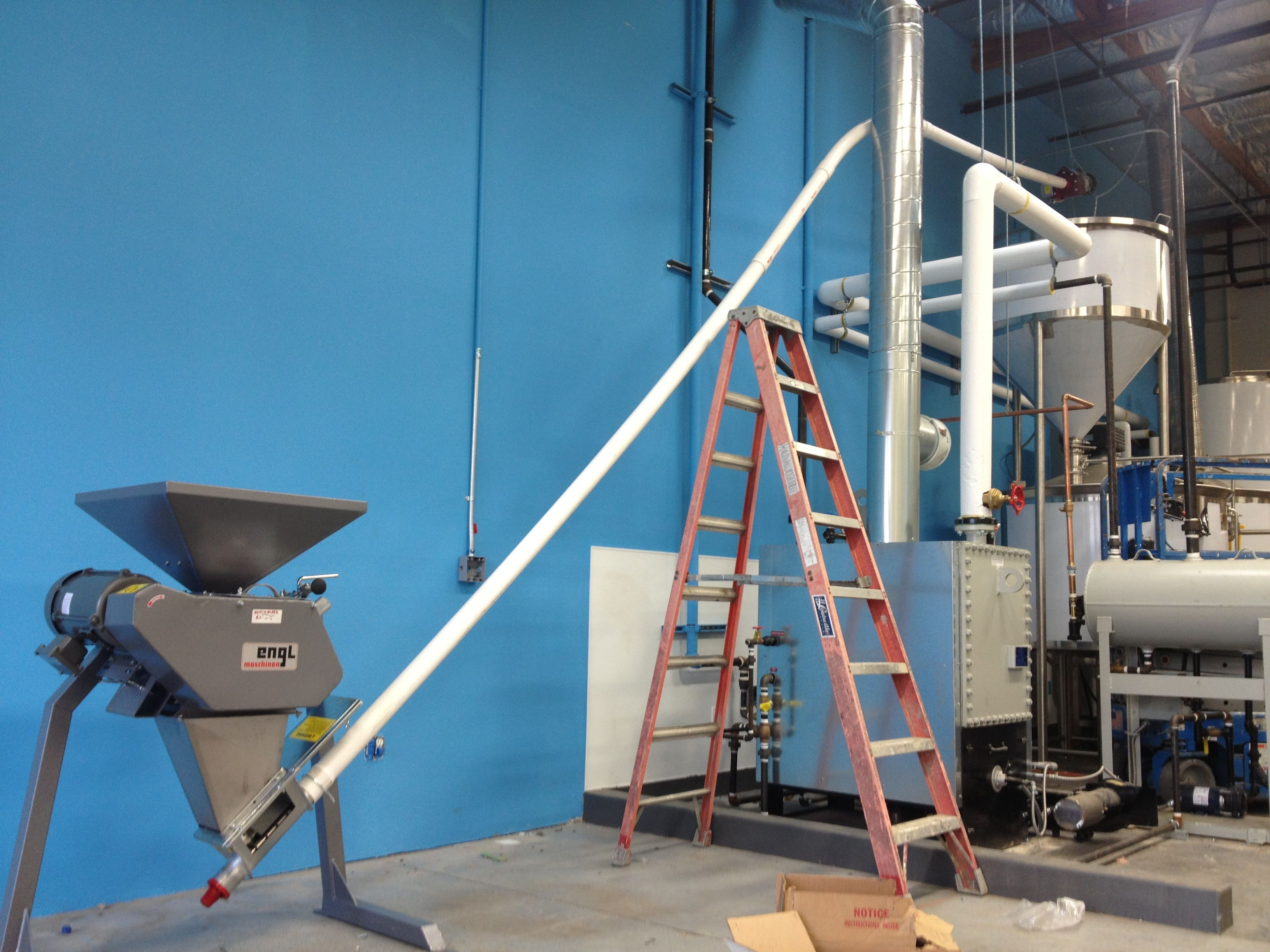 The mill, auger and grist case installed and ready to go | The Space