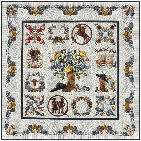 """Happy Trails, 70 x 70"""", album style quilt by Pearl P. Pereira at P3 Designs.    The 24"""" center block is surrounded by twelve 12"""" blocks.   The  finishing touch is the barbed wire swag border filled with roses, purple sage, blue bonnets, wagon wheels and  stars."""