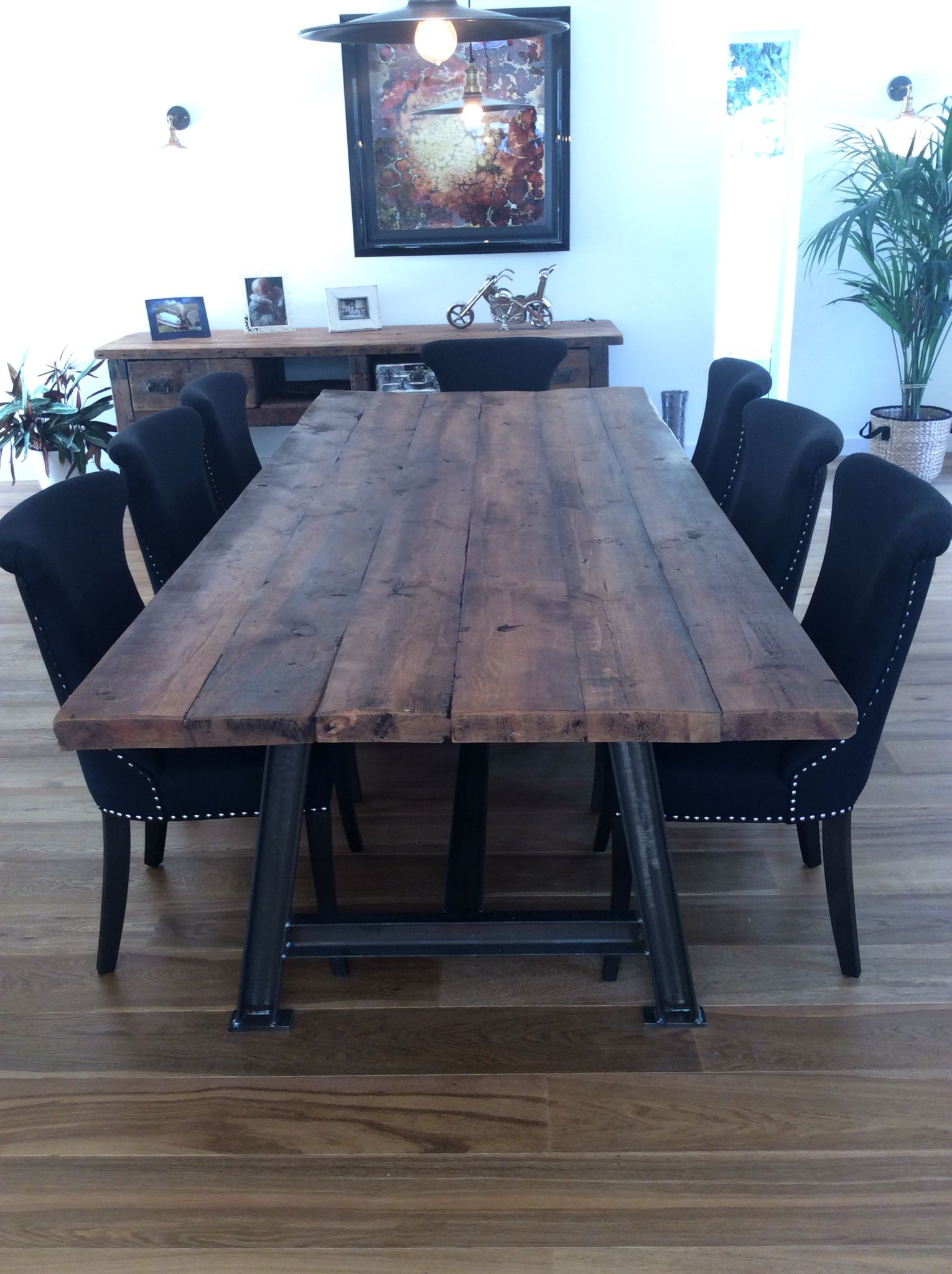 Industrial style steel A framed table with reclaimed timber top