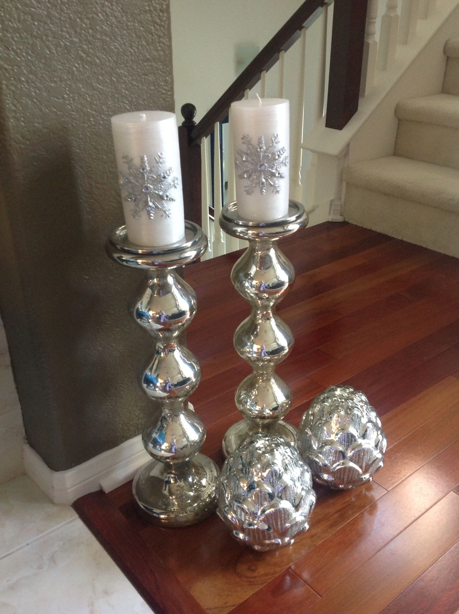 make Christmas candle holders from stair spindles or posts by painting them  silver of light blue
