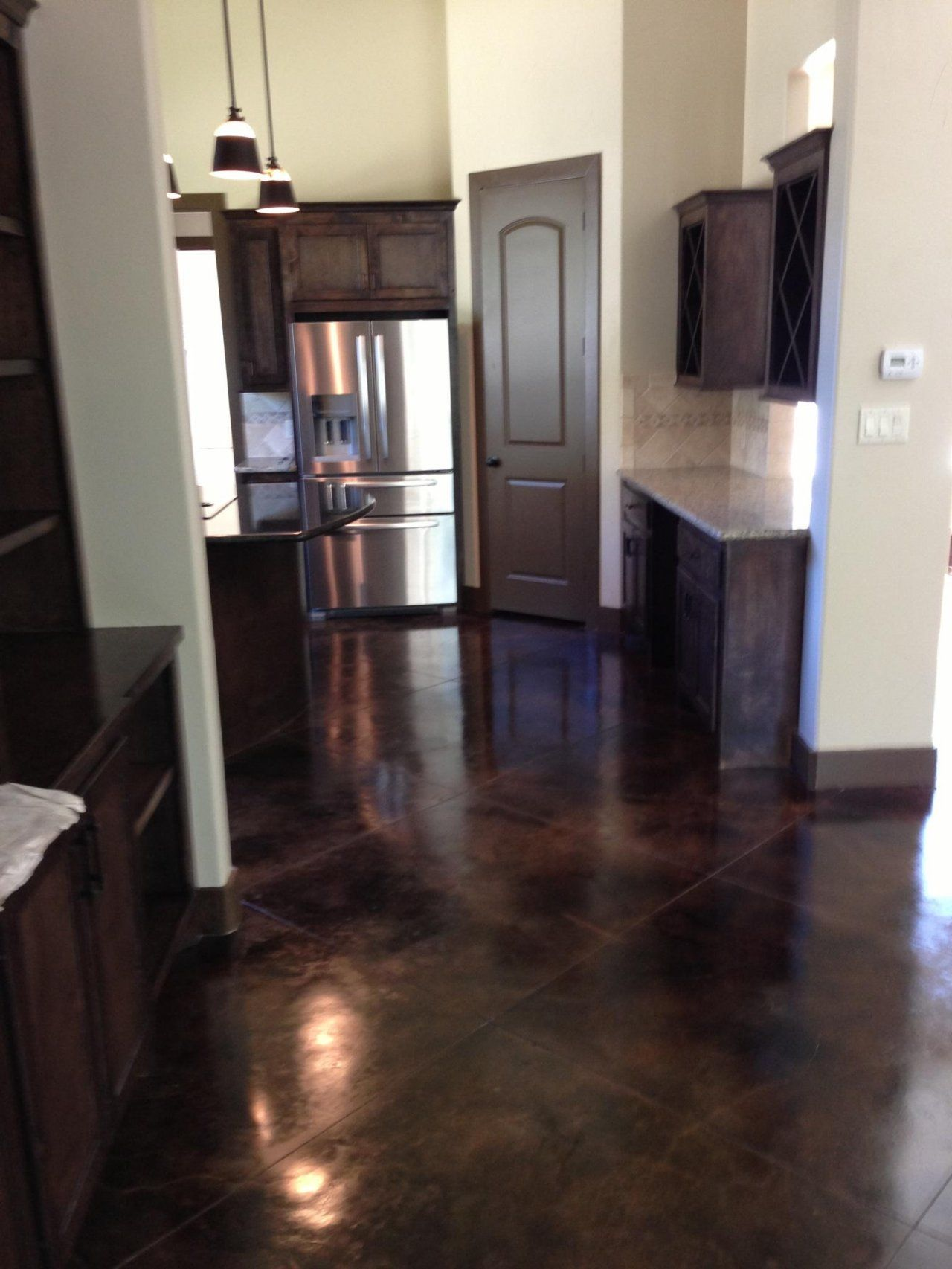 Scored And Stained Concrete Kitchen In Houston Texas Concrete Kitchen Floor Stained Concrete Floors Kitchen House Flooring