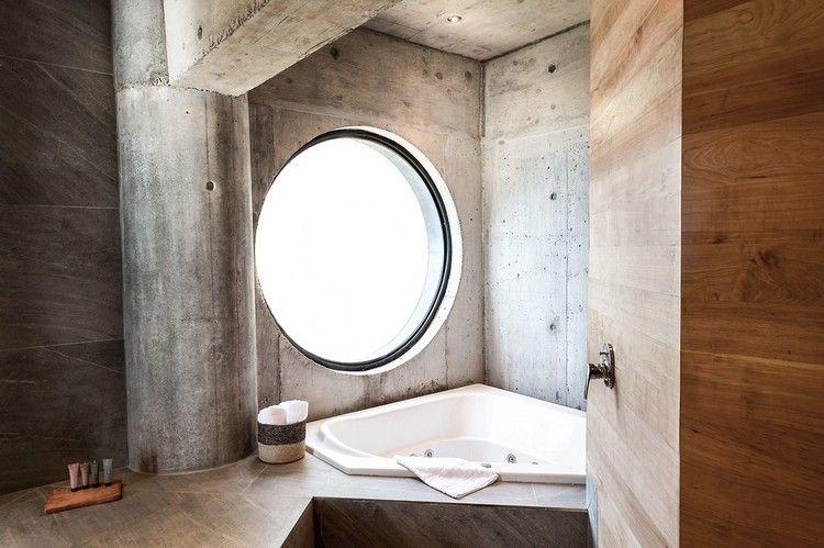 Fenster Badezimmer ~ Minimalistisches bad mit betonwänden und rundem fenster badezimmer