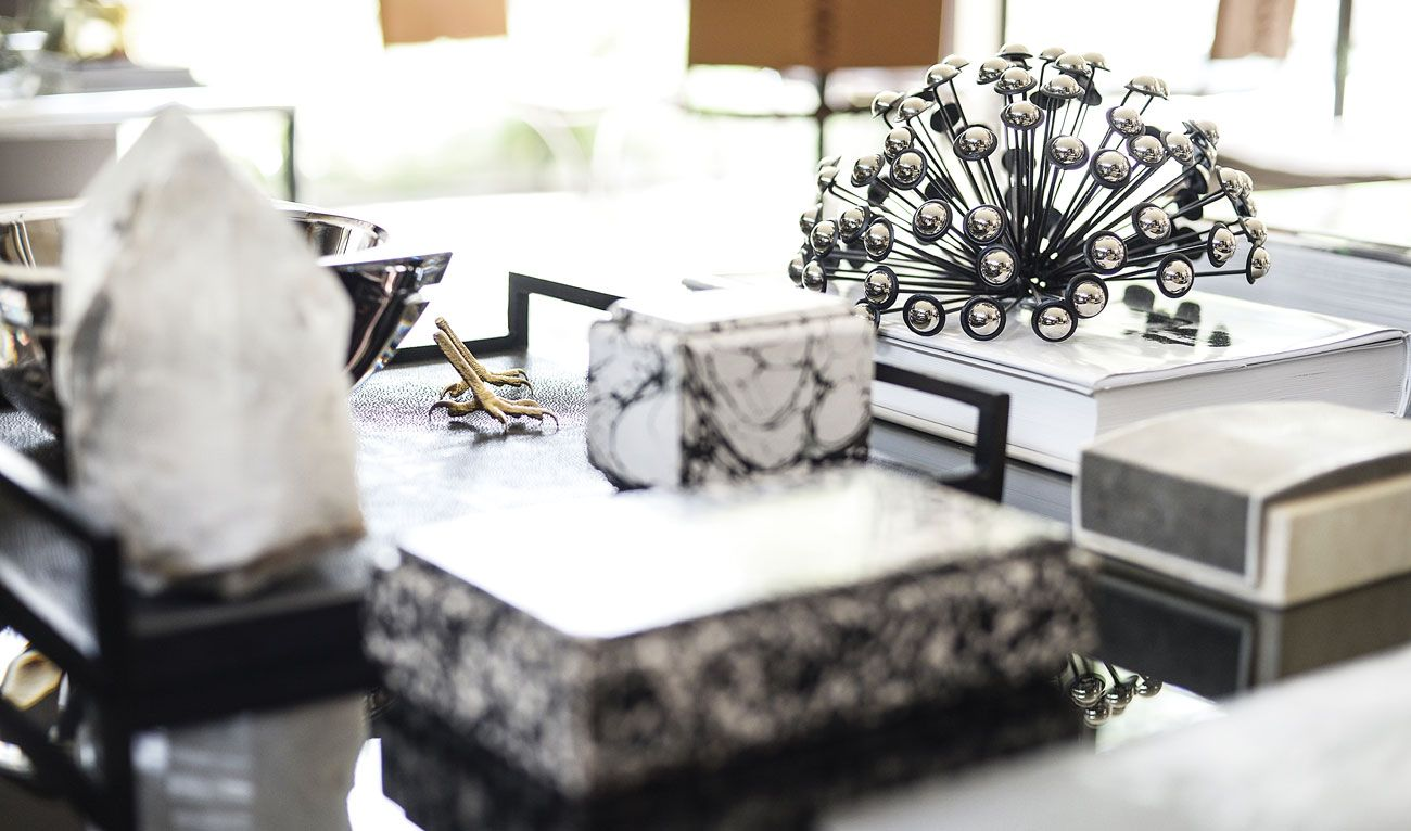 """""""My vintage black-and-brass Mastercraft credenza, a large black-and-white photograph by Tatiana Gerusova and a pair of Cleo Renault vintage LuciteLux® lamps from Leslie Pritchard at Again & Again."""""""