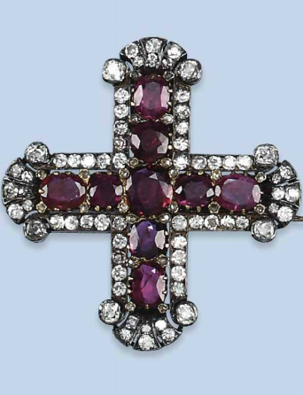 AN ANTIQUE RUBY AND DIAMOND BROOCH  The cross-shaped brooch set with oval-cut rubies surrounded by old-cut diamonds, 19th Century