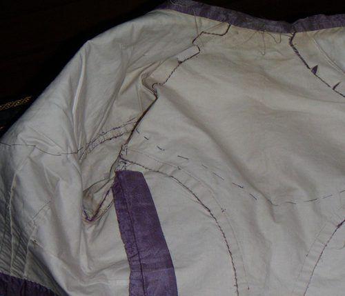 """1860s lilac silk dress with bobbin lace and velvet ribbon trim. Body lined in white cotton sateen. Skirt lined in a """"stiff cotton fabric"""" with sateen hem facing. From Antiques Atlas."""