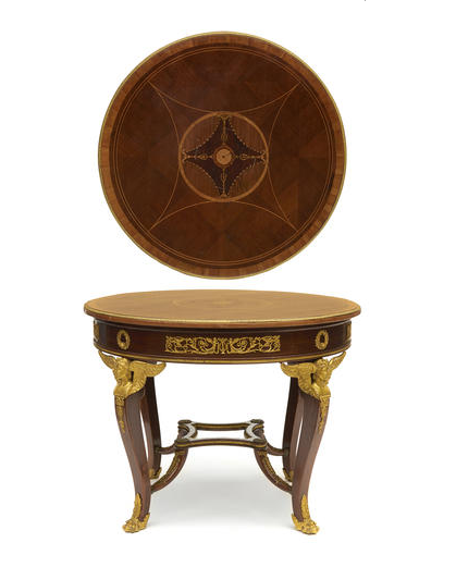 An Empire style gilt bronze mounted marquetry inlaid mahogany table de milieu