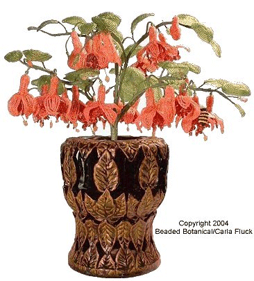 Beaded Flowers -Fuchsia in Leaf Carved Container by Carla Fluck.