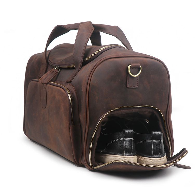 Handmade Vintage Crazy Horse Leather Duffle Bag Travel Bag with Shoes Compartment 1081 is part of Duffle bag travel - Macbook, many clothes, an IPAD, A4 files, books, magazines, as well as many accessories  Also, there is one shoe compartment on the side of the bag, which is very easy to put in and take out the shoes   Features 1  Long Adjustable Shoulder Strap 2  Solid AntiRust Hardware 3  Canvas Lining 4  Inside zipper pocket, 1 cell pocekt, 1 purse pocket  Dimensions Length 52cm; Height 29cm; Width 22cm; Color Dark Brown