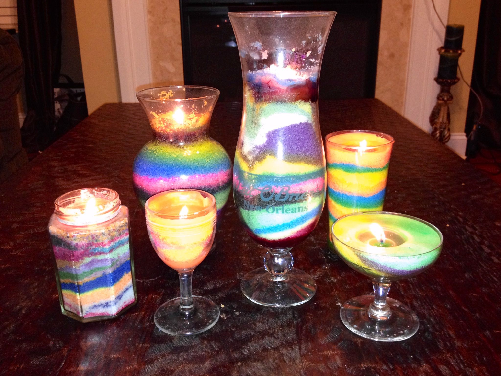 DIY- candles. You can use any clear glasses, even old flower vase. My favorites are the antique glasses that weren't doing anything but collecting dust, and a collectors glass I purchased on a vacation. Just pour colored wax beads and place a wax coated wick in middle. You can also add your favorite fragrance as you add wax beads to enjoy as you burn the candles!