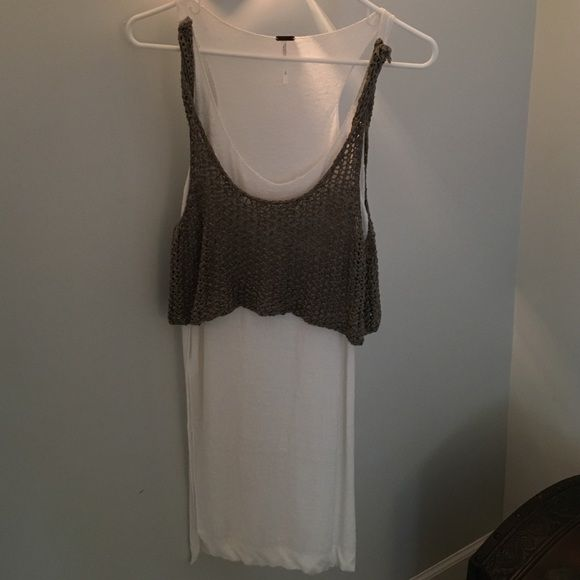 Free People tunic Free People tunic. In between a white and light cream with an olive color top. Never worn! Free People Tops Tunics