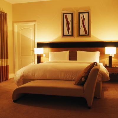 The Minimum Room Size For A King Size Bed Hunker Yellow Bedroom Decor Simple Bedroom Bedroom Decor Design