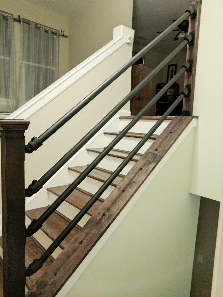 Electrical conduit and cedar post diy handrail stair