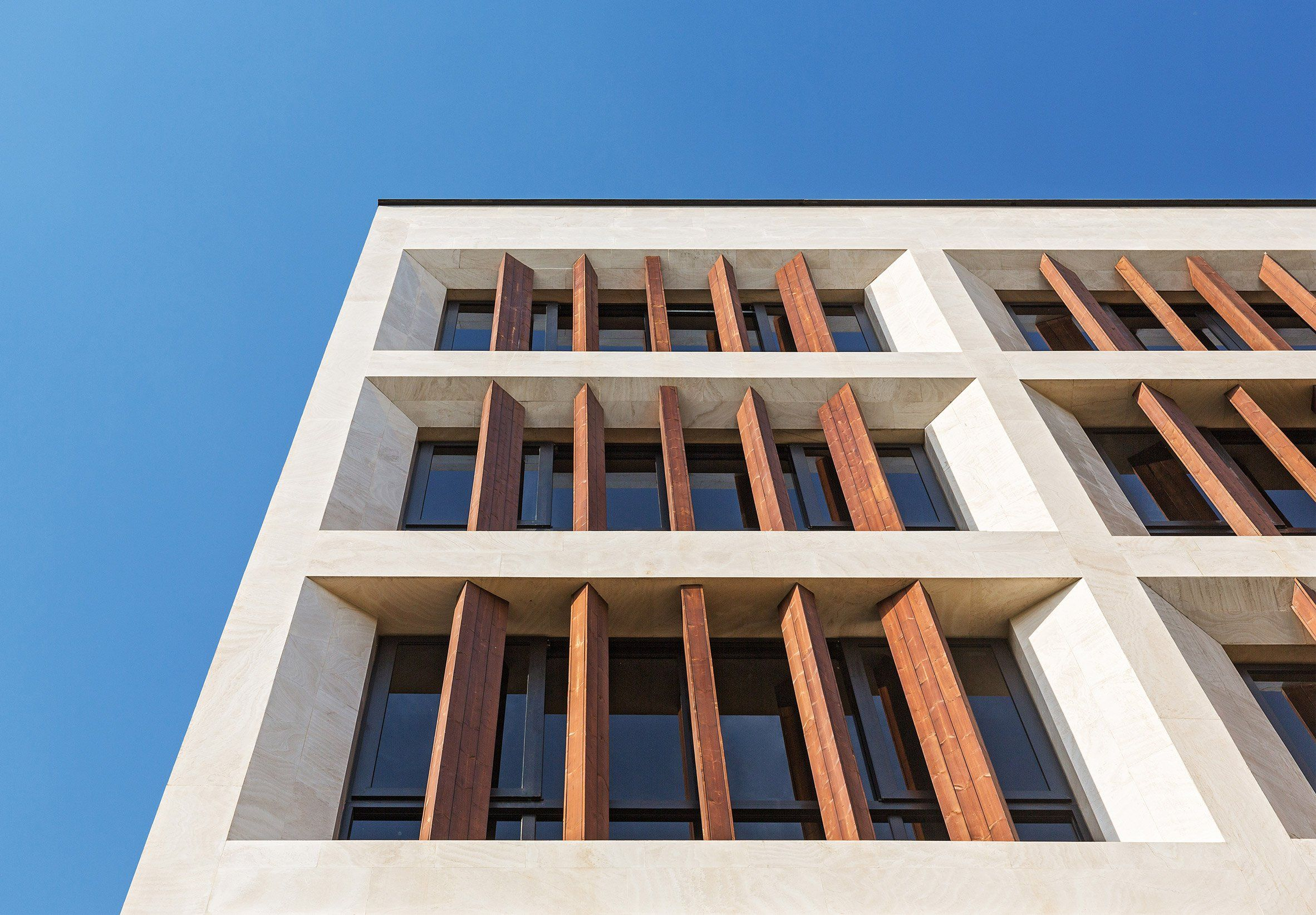 Tehran office building features facade divided into a grid ...