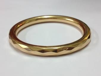 An Old Rose Gold Slave Bangle With Diamond Cut Design Dated Chester