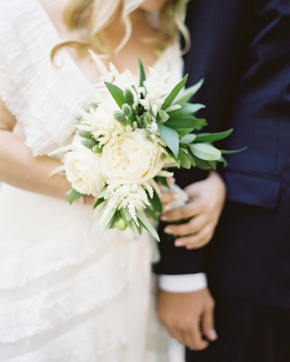 Floral designer Mindy Rice fulfilled Emily's vision for a bouquet that was both pretty and natural with a lush combination of garden roses, astilbes, native bay leaves, millet, and scabiosas.