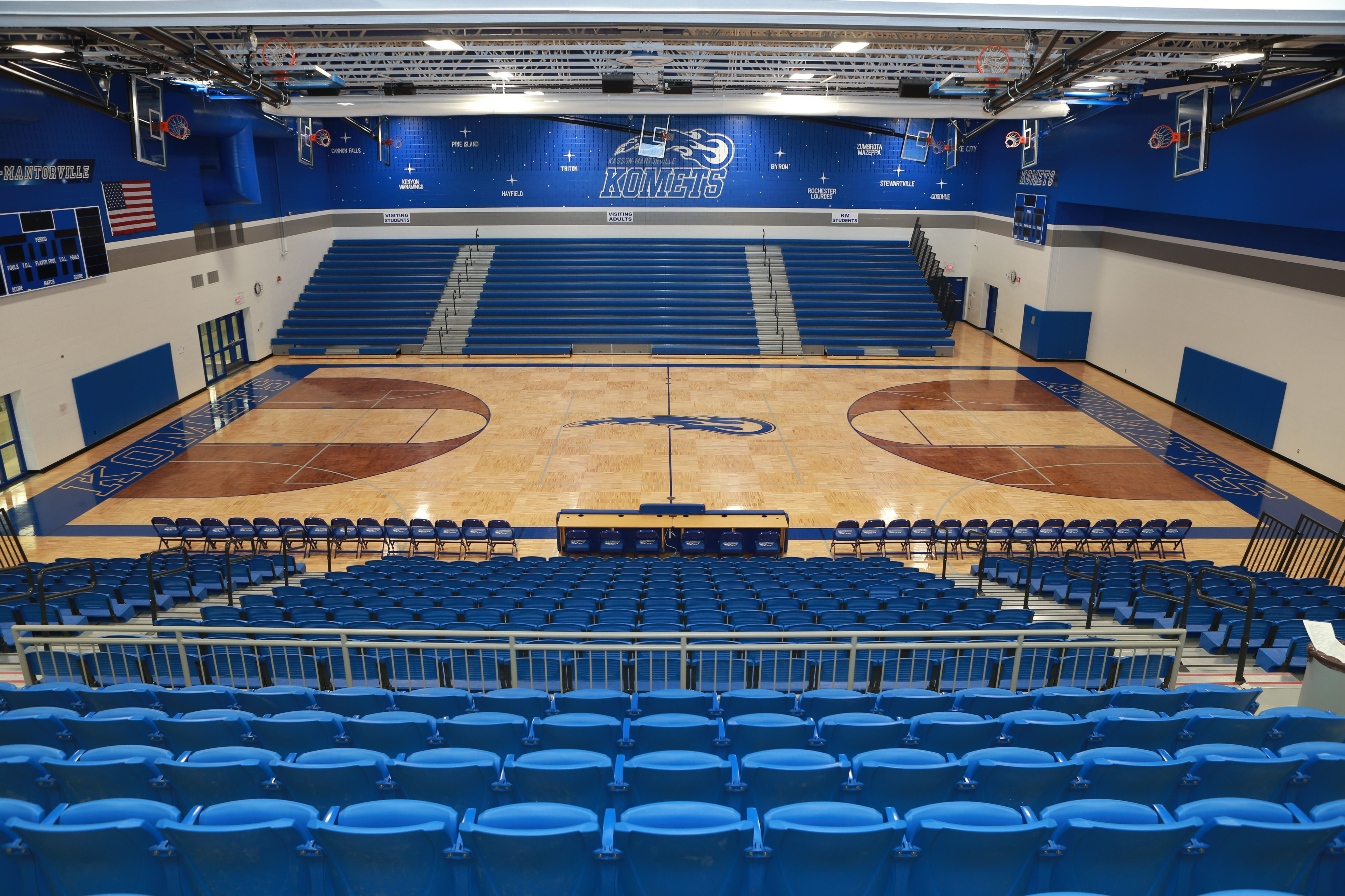 Kasson Mantorville High School Gym Opens To Commons Area Bright Colors Floating Wood University Interior Design Gymnasium Architecture School Architecture