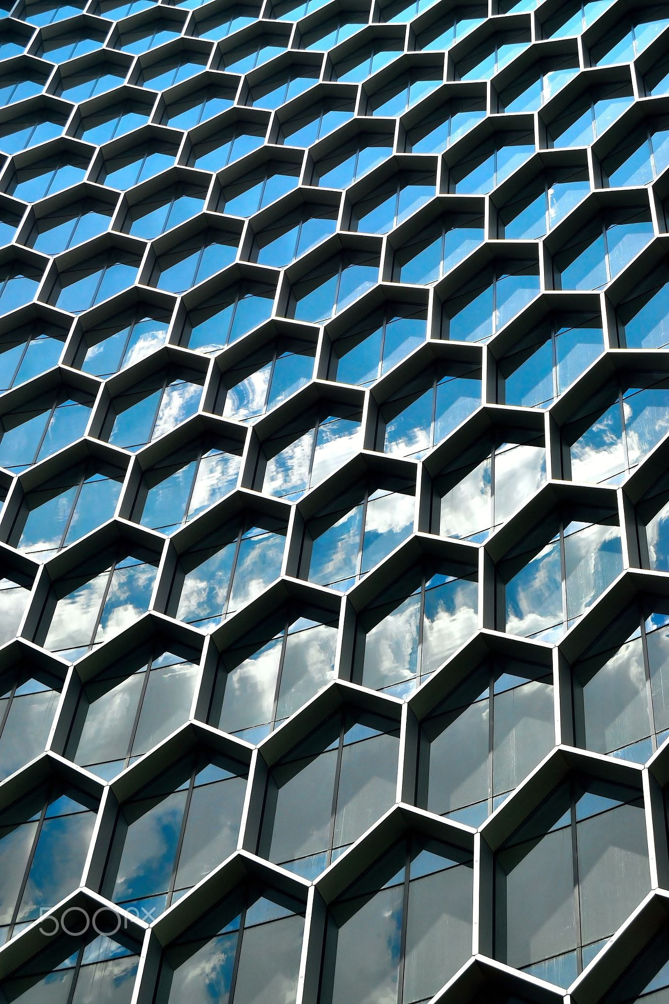 Hive Too - Vertical hexagonal geometry framing the sky in downtown ...