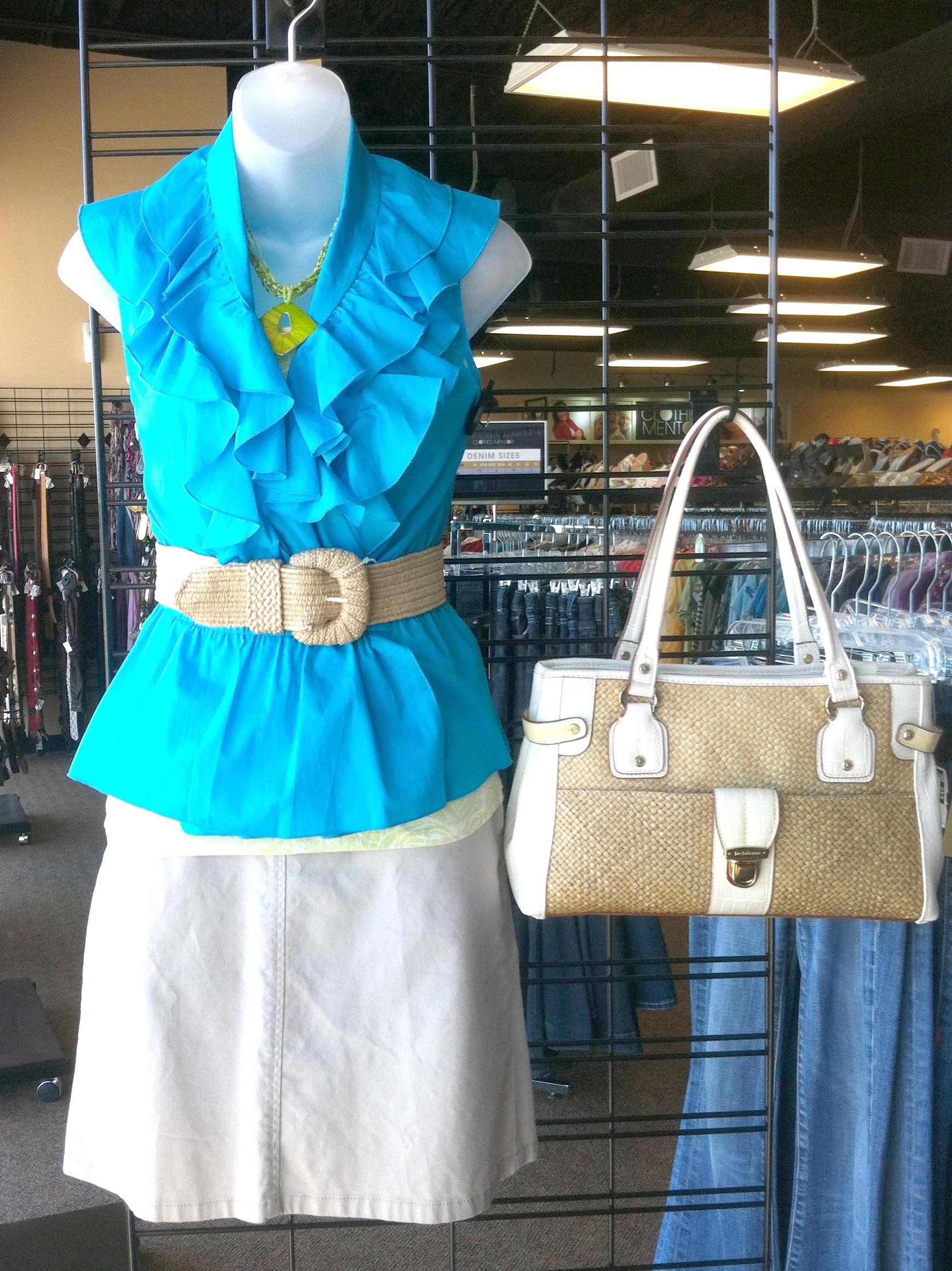 Blue ruffled sleeveless top with white skirt