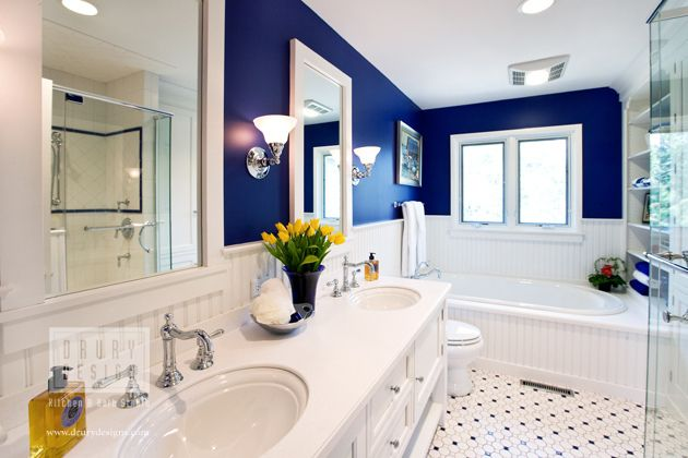 Traditional Bath by Drury Design Kitchen & Bath Studio, via drurydesigns.com - royal blue walls with crisp white tub, beautiful tile floor...