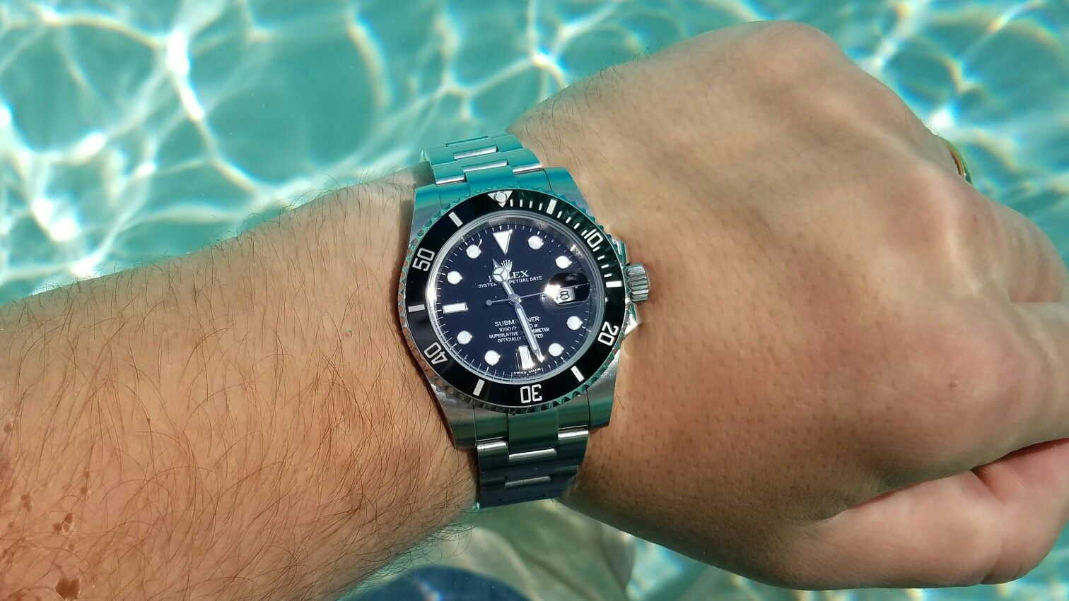 Rolex submariner ceramic wrist shot, vacation, summer