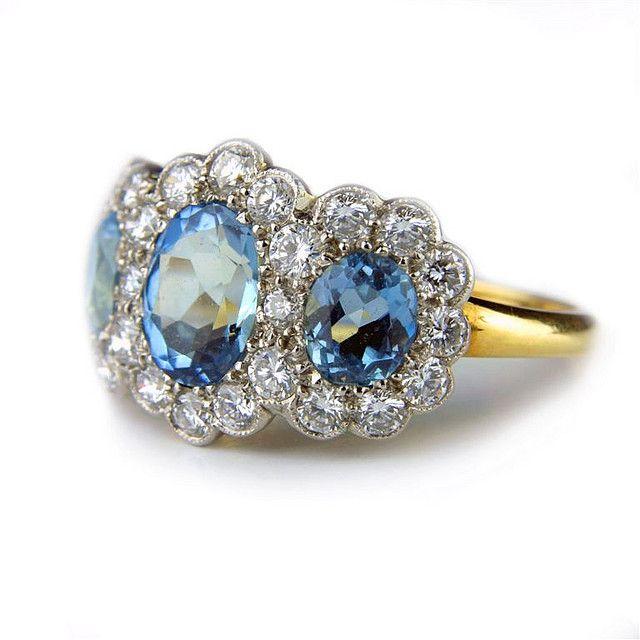 Triple aquamarine and diamond cluster engagement ring by rmrayner, via Flickr
