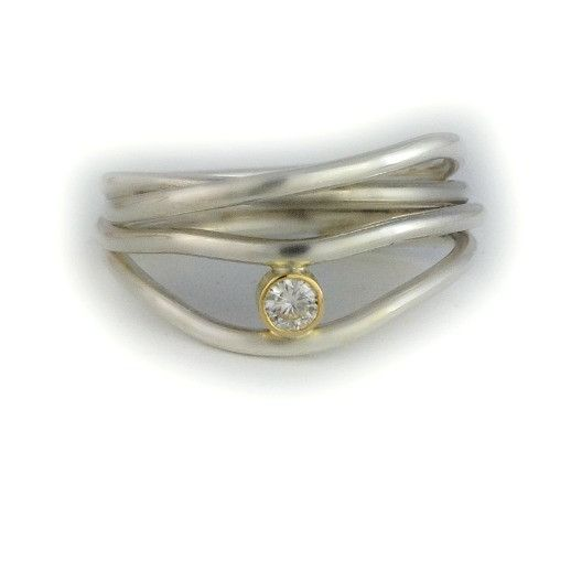 Reflections Wave Ring... where light goes dancing. Sterling silver multi wave ring, 18kt yellow gold bezel set Moissanite. http://jeanette-walker-jewellery.myshopify.com/products/relections-wave-ring