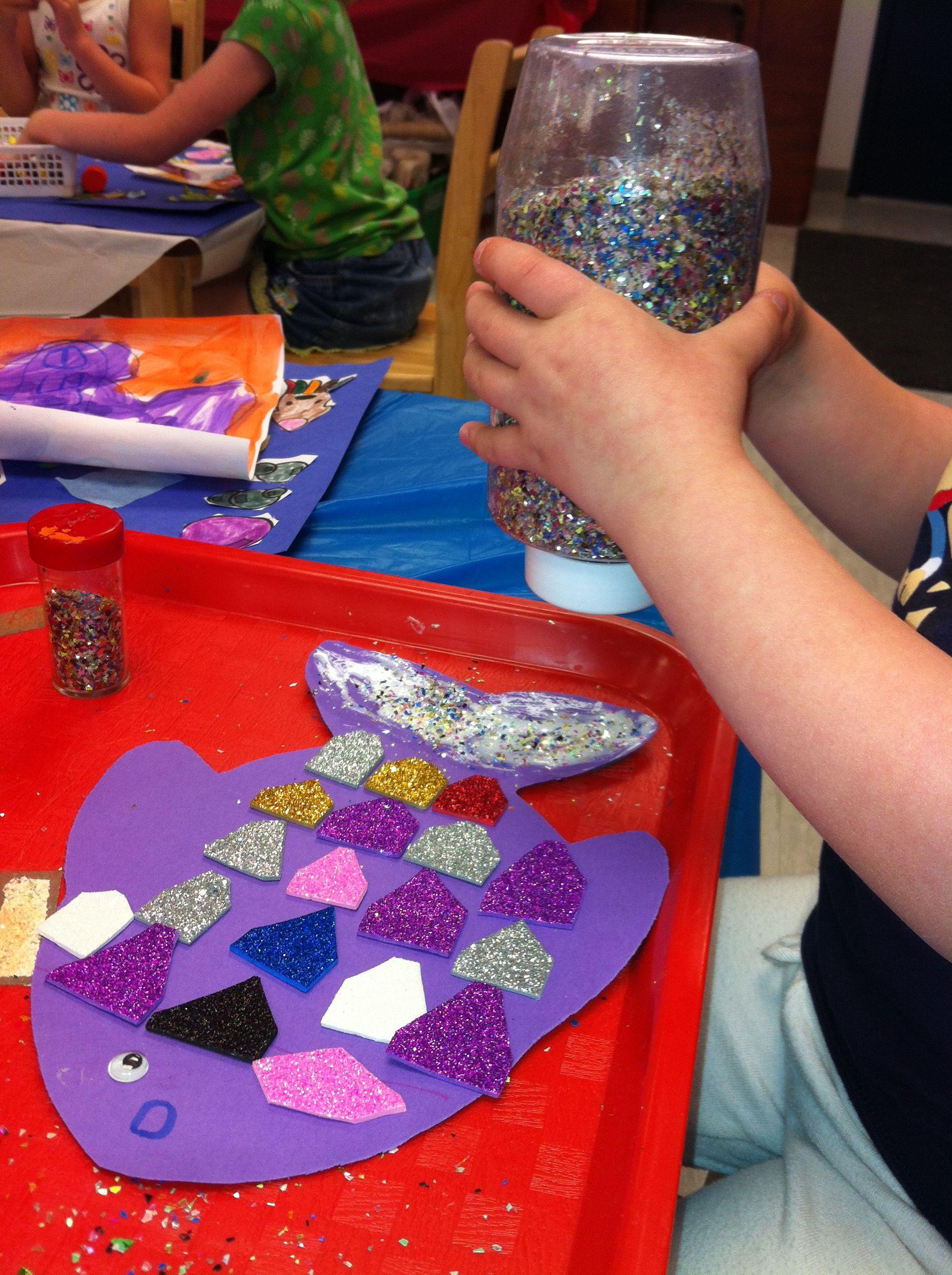 Rainbow fish inspired craft: card stock fish shape, glittery sticky ...