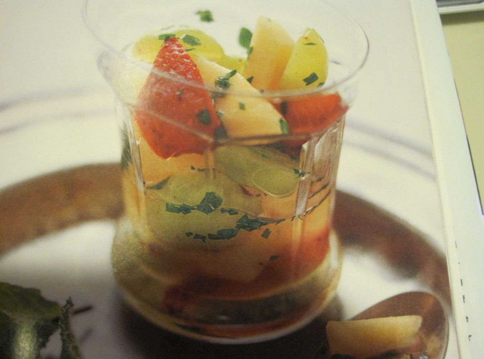 Cantaloupestrawberries and grapes wwhite wine and mint