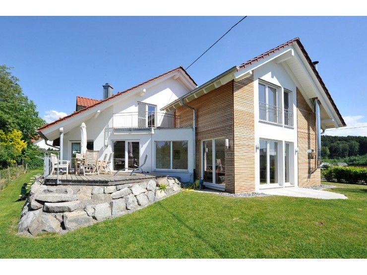 Natur 67 einfamilienhaus von frammelsberger r for Blockhaus modern einrichten