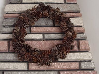 Pine cone wreath. I make mine with wire and a wire frame and put a wide ribbon around it with a big bow. This year I think I will try glue and a foam frame. I have one in the kitchen year around and hanging on back door inside. Great for Fall and Christmas